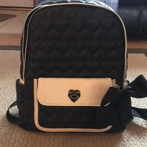 Trendy black and cream leather backpack